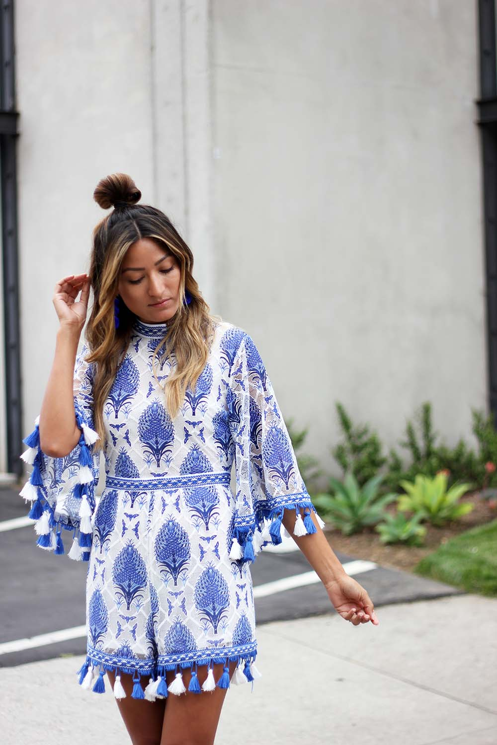 The Blue Romper of My Dreams , little mistress uk, blue printed romper, ethnic printed romper, tassel romper, melrodstyle, ootd, outfit, summer, trending, who what wear, bun life, top knot, pom pom earrings, blue on blue, latina blogger, la blogger, street style, blogger style,